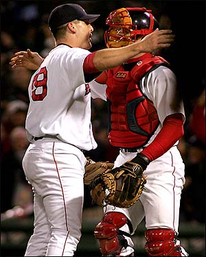 Jason Varitek greets Foulke on the mound with a hug.