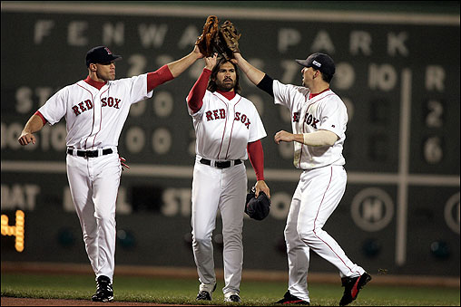 With Game 2's 6-2 victory safely behind them, Red Sox outfielders (left to right) Gabe Kapler, Johnny Damon, and Trot Nixon converge for a celebratory tapping of their gloves on Oct. 24. &nbsp; <img src='http://cache.boston.com/bonzai-fba/File-Based_Image_Resource/dingbat_arrow_icon.gif' alt='' title='' height='9' width='4' border='0' /> Story More photos