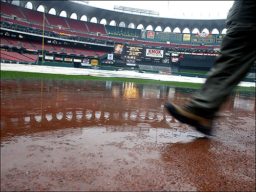 The field at Busch Stadium three hours before game time was soaked, the infield covered with a tarp, and the dirt near home plate was under water.