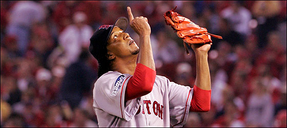 Red Sox pitcher Pedro Martinez pointed to the heavens after shutting out the Cardinals on three hits in a seven-inning stint.