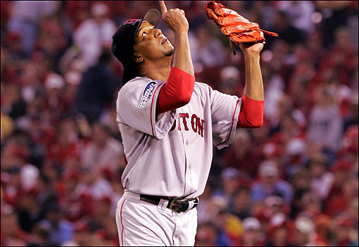Red Sox pitcher Pedro Martinez pointed to the heavens after shutting out the Cardinals on three hits in his seven-inning sting during Game 3 on Oct. 26. The Sox beat the Cards 4-1. &nbsp; <img src='http://cache.boston.com/bonzai-fba/File-Based_Image_Resource/dingbat_arrow_icon.gif' alt='' title='' height='9' width='4' border='0' /> Story &nbsp; More photos