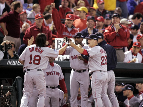 2004 World Series Game 4: Damon celebrates at the top of the dugout after his first inning home run.