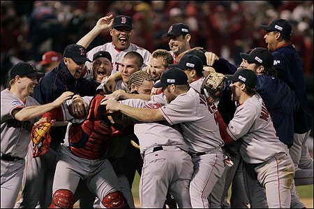 The 2004 Red Sox team celebrates after winning the World Series in St. Louis Wednesday night.