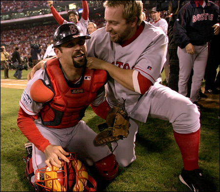 Jason Varitek (left) and Kevin Millar take a turf moment to savor the title.