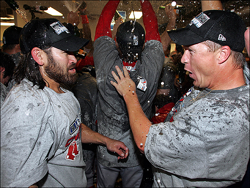 Johnny Damon and Mike Timlin celebrate under a shower of champagne.