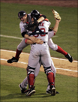 It's a postseason celebration unlike any in team history as Doug Mientkiewicz (facing) and Jason Varitek have closer Keith Foulke sandwiched after the final out. <img src='http://cache.boston.com/bonzai-fba/File-Based_Image_Resource/dingbat_arrow_icon.gif' alt='' title='' height='9' width='4' border='0' /> Story