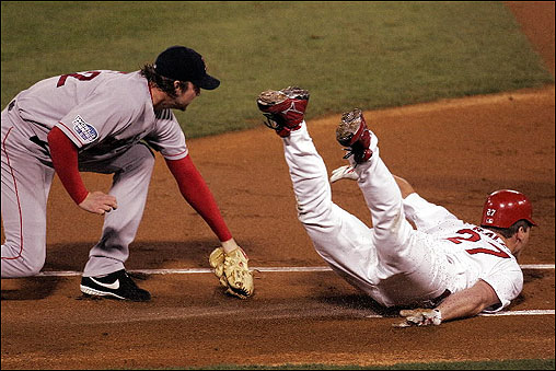Derek Lowe took matters into his own hands for an unassisted out in the first inning, tagging a diving Scott Rolen along the first-base line after fielding the Cardinal slugger's weak grounder.
