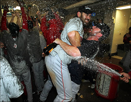 An uplifted Johnny Damon is in the middle of a bubbly celebration as the Red Sox get swept up in the occasion.