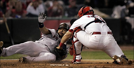 Not everything went the Sox' way, as Manny Ramirez found when he tried to score on a third-inning grounder.