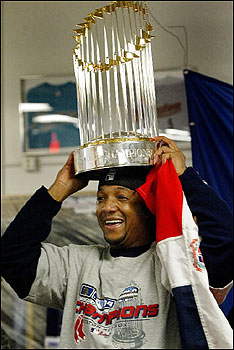 Pedro Martinez has never been happier about a new hat, but then again, that hat is the World Series trophy.