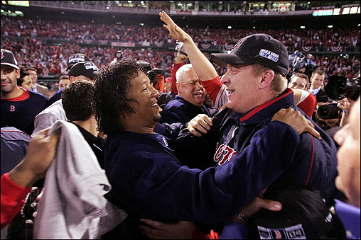 Staff aces Pedro Martinez (left) and Curt Schilling celebrate, the winners of Game 3 and Game 2 respectively, embrace after the Sox swept the Cardinals for the World Series win.