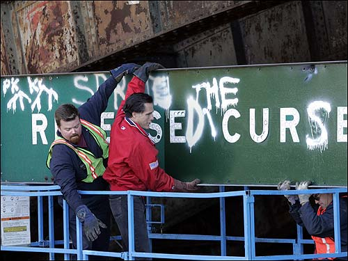 Mitt Romney helped remove the 'Reverse the Curse' sign from the Longfellow Bridge on Storrow Drive.