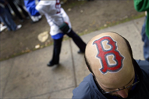 On Boylston Street near the Commonwealth Avenue overpass, Jonathan Wiencek, 23, of East Taunton, makes the best of premature balding by painting a Red Sox 'B' symbol on his dome.