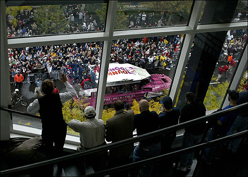Fans watch the parade from the Hynes Convention Center on Boylston Street.