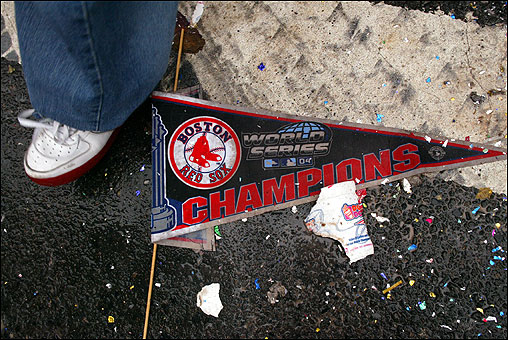 As crowds disperse from the Boston Common, a dropped pennant is trampled.