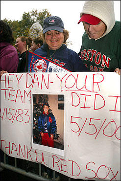 Kathy Faro (left) from New Bedford holds a sign with a photo of her son, Danny Andrzejczuk, 19, who died in 2000 from mononucleosis. He was an avid Red Sox fan. 'All he wanted was for them to win. I had to come here for him,' she said. With her was Sarah Hontz, who was in the New Bedford High School band with Danny.