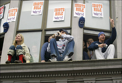 These fans got a birds' eye view of the parade on the corner of Massachusetts Avenue and Boylston Street.