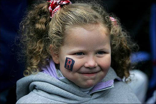 Alyssa Walsh-Piwowarski, 4, of Beverly, sports a ''B'' on her cheek and Red Sox hair ties in her curls while waiting for the Sox on Boylston Street.