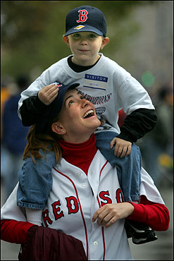 Sean MacKinnan, 6, of Dedham, sits on the shoulders of his aunt, Allison Troiani of Westwood, as they walk along Boylston Street.