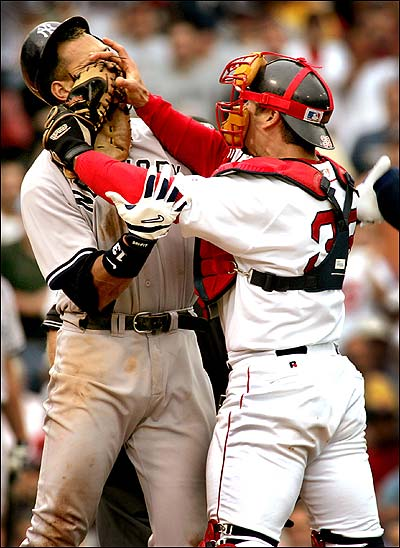 Jason Varitek gives Alex Rodriguez a face full of catcher's mitt, setting off a benches-clearing incident July 24.