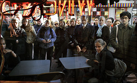 People stopped outside Cardullo's Gourmet Shoppe in Harvard Square yesterday to listen to Senator John Kerry's concession speech.
