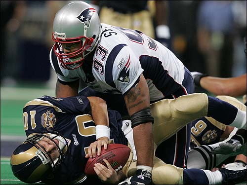 Richard Seymour gets up close and personal with Marc Bulger after a fourth-quarter sack.