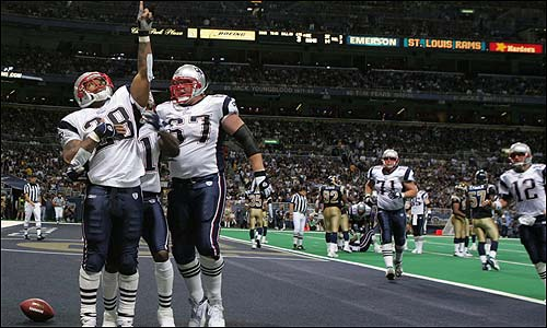 The Patriots offense got a boost with Corey Dillon back in the lineup. Dillon celebrates with Dan Kopppen after his 5-yard touchdown run during the third quarter.