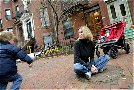 Shauna Rives with her two sons, Jack, 3, and Gabriel, 9 months, outside their condo building with the double stroller that Rives leaves in the downstairs hallway, causing a fuss with neighbors. ''We tried to resolve it in the nicest way possible,'' she said.