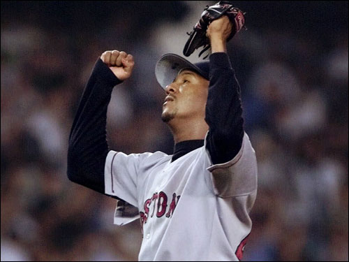 Pedro Martinez celebrated after registering the last of his 17 strikeouts against the Yankees in New York. Martinez went nine innings in what could be considered his best start in a Red Sox uniform.