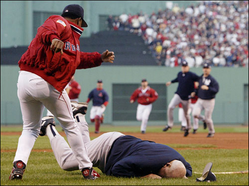 In a now infamous photo, Martinez threw Yankees bench coach Don Zimmer to the Fenway turf after Zimmer charged at Pedro from the dugout.