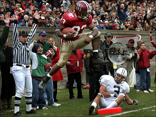 Clifton Dawson scored Harvard's first touchdown of the game, leaving Yale defender Barton Simmons behind.