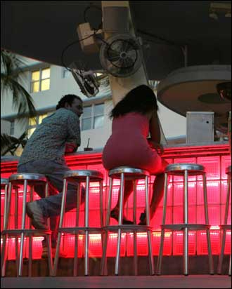 Patrons at the outside bar at the Clevelander Hotel, along Ocean Drive, enjoy the warm breezes at the bar.