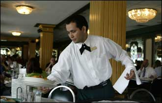 Waiter Alvaro Luna works at the Versailles restaurant in Little Havana. The restaurant is a landmark among local Cubans.