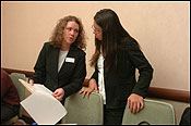 Top, Jacquelin Sanchez looked for the Jurys Hotel, where she helped Ernst & Young's Joan Looby (middle) organize an orientation. Later, Sanchez and Maggie Boyd examined accounting forms.