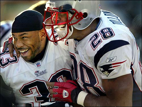 Corey Dillon, right, who already had two touchdowns, is all smiles as he commends fellow running back Kevin Faulk on his touchdown.