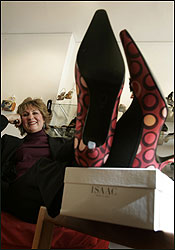 With her size 11 1/2 shoes propped on her desk, Barbara Thornton looks right at home inside her Newbury Street office.