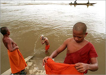Buddhist monks bathe in the Sekong, a tributary of the Mekong, in Siempang, Cambodia.