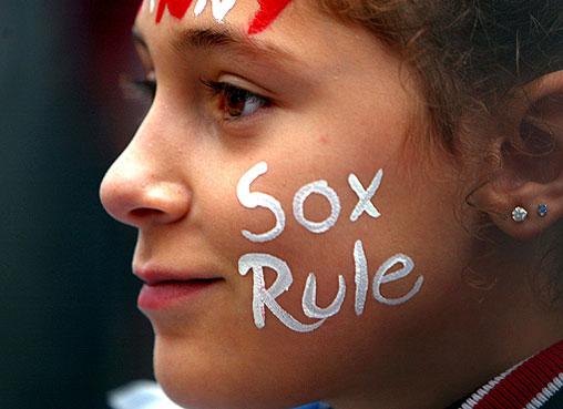 During the parade celebrating the World Series Champion Boston Red Sox, Nicole Kazanjian, 11, from Lowell, watched the players pass her location on Tremont Street in front of the Common.