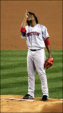 Oct. 13: It was a roller-coaster ride of a Red Sox season, but when the Olde Town Team faced the Yankees for the American League championship, it was a test of fans' blood pressure. Here, during Game 2 of the ALCS, Pedro Martinez pointed to the sky during the first inning in response to crowd chants of 'Who's your daddy?' Despite the appeal for divine aid, the Sox lost, 3-1.