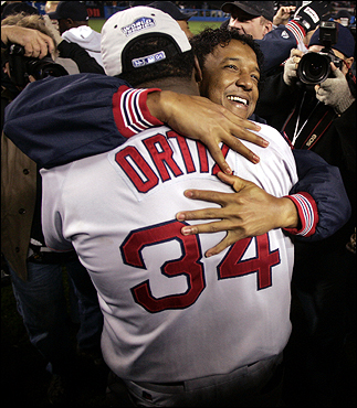 Pedro Martinez hugged David Ortiz as the Red Sox celebrated on the field at Yankee Stadium.