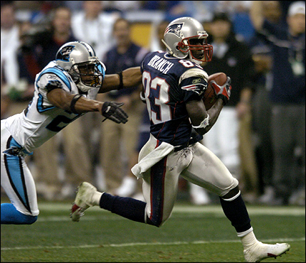 Deion Branch ran from Ricky Manning Jr. of the Carolina Panthers after catching a pass from Tom Brady during the second quarter of Super Bowl XXXVIII. This catch set up the Patriots for their second touchdown.