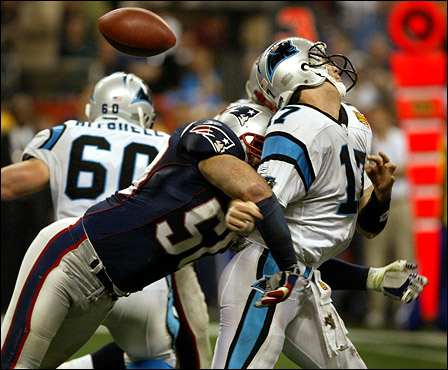 Even if you weren't a sports fan at the start of 2004, you might have become one after this awe-inspiring season of two New England championships. Feb. 1: The New England Patriots started the year by winning the Super Bowl. Here, Patriots linebacker Mike Vrabel knocked the ball out of the hand of Carolina Panthers quarterback Jake Delhomme, causing a second-quarter fumble that was recovered by the Patriots.