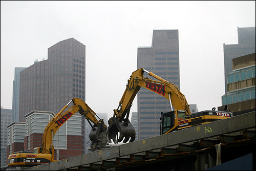 In the Boston area, news was dominated by transportation changes and an ongoing struggle within the Roman Catholic Church. Here, construction equipment tears down the old elevated Central Artery near the North End in January.