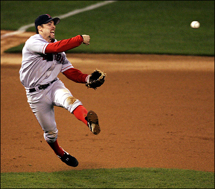 Oct. 26: In Game 3 of the World Series, Red Sox third baseman Bill Mueller throws to first baseman David Ortiz on a ground ball hit by Scott Rolen. The Sox took this one, 4-1, and excitement built to a fever pitch in Red Sox Nation.