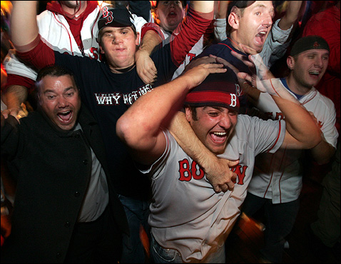 Back home, Sox fans celebrated the Red Sox World Series victory at the Who's on First? bar near Fenway Park.