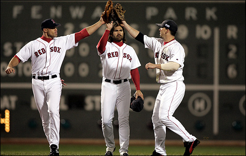 With the final score visible behind them, Red Sox outfielders Gabe Kapler, Johnny Damon, and Trot Nixon celebrated the Game 2 victory.