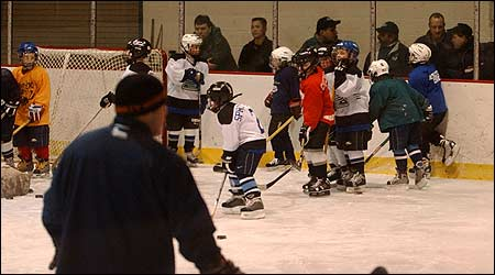 The Salem-Swampscott Mite hockey team practiced, as onlookers, including parents, watched in the background yesterday at the William Connery Rink in Lynn. (Globe Photo / Lisa Poole)