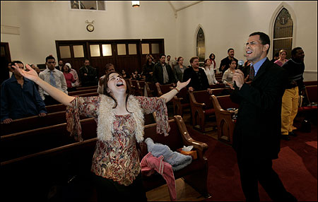 Pastor José Teófilo Alcántara and his wife, Jeannette Rodriquez, led their congregation in song last week at Christ Community Church.