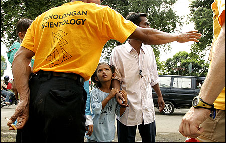A volunteer from the Church of Scientology directed refugees seeking assistance in Banda Aceh, Indonesia. The organization is using massage therapy, which it calls ''nerve assists,'' to treat survivors of the tsunami.