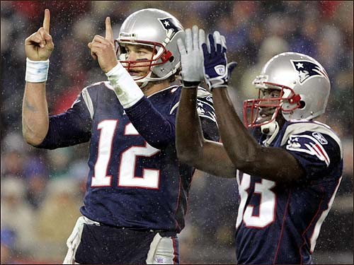 Tom Brady (left) and wide reciever Deion Branch differ on how far New England is from the goal line.